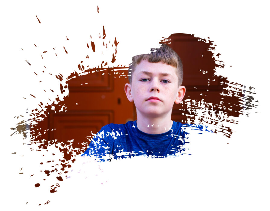 young boy in a paint splattered template